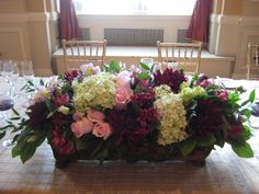 Jaw-Dropping beautiful arrangement for your head table artist! need to be low
