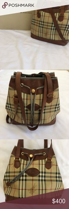 Authentic Burberry Haymarket Bucket Bag Purse 100% Authentic Burberry Haymarket Plaid Check Bucket Bag. VGUC beautiful vintage piece. Leather is supple and soft. Canvas and Inside are in overall clean condition see pics. Only signs of wear is pretty much the drawstring and smells like perfume. Handles are soft and show no cracking. Again, this is a authentic VINTAGE piece. If you're looking for a brand new one I'd suggest to go to the Burberry store and buy it for $1,500.00 If you are not…