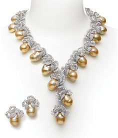 Flora Necklace & Earring Set This stunning necklace and earring set features 17.5x15mm Baroque Golden South Sea cultured pearls on the necklace and 15mm Baroque Golden South Sea cultured pearls on the earings with 112.30ct diamonds, set in 18k white gold.