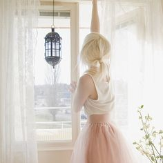 Loose white singlet and pale pink tulle.