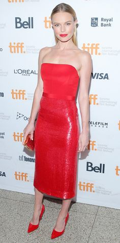 Kate Bosworth selected a red-hot sequined Boss number for the Still Alice premiere at TIFF, accessorizing with a rose gold-silver mirrored Lee Savage clutch and red Kurt Geiger pumps.