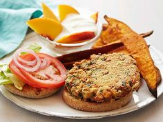A step up from the typical veggie burger, this meatless main is prepared with mashed pinto beans and kale and then stacked on a whole-wheat English muffin with lettuce, tomato and onion.