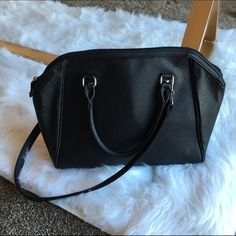 "H&M Faux Leather Handbag Beautiful black handbag. Clean, Smoke Free Home.  All Sales Final.  Fast Ship! Thanks! Check out my other items!                                                ✨✨✨✨✨15% off when bundled with another listing ✨✨✨✨  **NO TRADES or HOLDS PLZ** **will not reply to ""lowest""** H&M Bags"