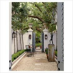 side yard with classical elements and clean boxwoods