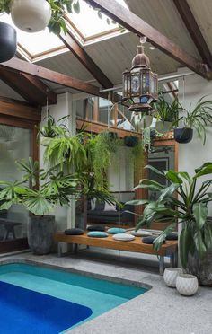 Hanging pots, combined with pot plants create greenery; add a built in BBQ and small plunge pool and this small space delivers a lot for warehouse dwellers. By Secret Gardens