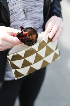 Golden triangles grace the exterior of this adorable clutch from Fluffy Co.