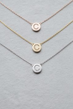 Charm initial letter necklace in gold, rose gold, and silver.