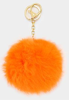 "New for Spring! These season's hottest accessory for your bag - a large fur pom pom keychain in orange! Pom Pom is 4.5"" X 5.5""."
