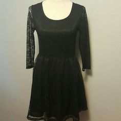 Black lace skater dress H&M Divided black lace skater dress. Sheer sleeves and back. Front and a line skirt are fully lined. Boat neck. One small rip in lace, see picture 4.  Shoulder to shoulder 15 inches.  Waist 30 inches.  Hips free.  Waist to hem 17 inches  As with all H&M items, their clothes run small. H&M Dresses