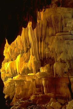 A caver gazes at a stone formation in Tham Lum Khao Ngu (Snake Mountain Cave) in Kanchanaburi, Thailand
