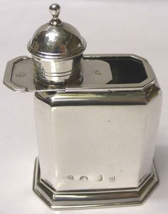 George I Silver Tea Caddy  A good early English silver caddy of plain rectangular design with canted corners. With sliding top and lift off cap which doubles as a tea measure. Britannia standard silver. Excellent patina and clear marks.