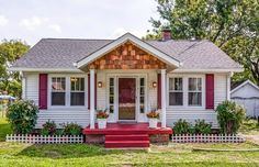 A 1920s Cottage Dials Up the Curb Appeal  - CountryLiving.com. 2 things I love... the 1920's era and red!  Love this house!  I want it!!!