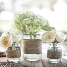 Simple and classy wedding centerpiece. Love the twine and mason jars!