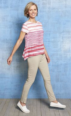 """Adding a contemporary twist to your spring wardrobe is as easy as slipping on this striped asymmetrical hem tee. The rayon blend flows beautifully, gently gliding over your curves. Easy Fit, our most relaxed style. Rayon/spandex. Washable. Imported.  <br />Sizes XS(4), S(6-8), M(10-12), L(14-16), XL(18-20); about 23"""" long."""