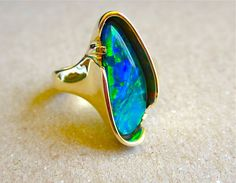 Lightning Ridge Black opal ring. One of a kind by Glenn Dizon. Just finished and available to one lucky person. Don't forget the Sausalito Arts Festival Labor day weekend. I will be in booth 500 with all my new creations.  I just love this stunning opal!