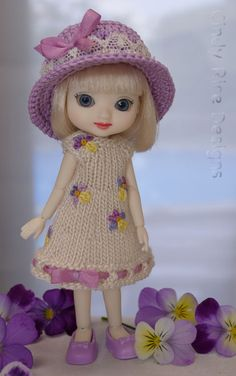 """Violas & Violet"", a hand knit dress and crocheted hat set for 4"" BJD Amelia Thimble dolls.  The dress is embroidered with the tiniest violas inspired by the real ones growing in my garden.  Her orchid colored hat is embellished with cotton cluny lace from England, seed beads, and silk ribbon."