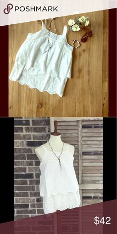 Double Layered Sleeveless Eyelet Tunic This white tunic has two layers of eyelet and adjustable straps. Perfect for summer! Umgee Tops Camisoles