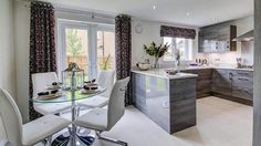 Show home room by room -The Maxwell, Frankfield Loch, Stepps by Taylor Wimpey - The stylish fully-fitted kitchen has an informal breakfast area that is a relaxed space to catch up for busy families, plus its high-gloss grey fully-fitted units create a style statement that will impress.