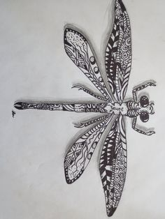 Zentangle dragonfly by luzilla.deviantart.com on @  sharon would like on a rock
