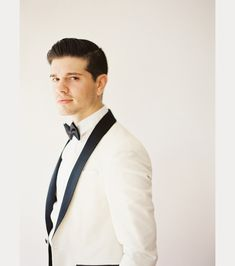 handsome groom in a white tux with black trim ~  we ❤ this! moncheribridals.com