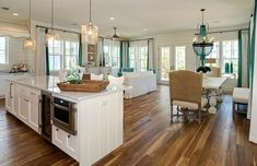 From my dreams.... medium tone wood floors, white on white kitchen, large island w/ 3 pendant lights, one LARGE room, no formal dining....ahhhhh