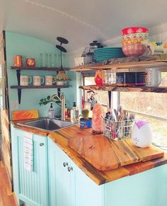 Camper Remodel Ideas 57  Love this idea... but how would you keep all of these in their place when hauling the trailer?