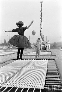 Trampolines, set into the ground.  Cool because you couldn't really fall off, then. Photograph by Ralph Crane.
