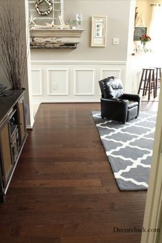 Gorgeous dark hardwood floors with light trim and griege walls