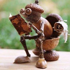 Man on toilet made of acorns