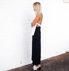 Karissa Sparke of Tom Girl & Threads wearing an black maxi skirt + white tank with open sides // Photo: Karissa Sparke