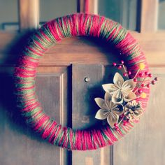 DIY Christmas yarn wreath with paper flowers! Will start blogging soon at beeandbunny.com  :)
