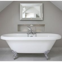 White and silver roll top bath