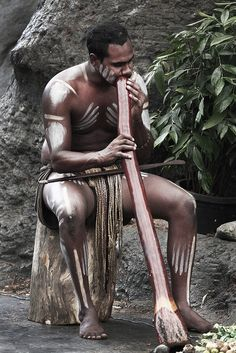 Australia: Playing the traditional Aboriginal musical instrument, the didgeridoo