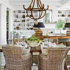 Fresh & Friendly Beach House Dining Room | When you're working in such a limited color range, patina and texture become very important design elements. This room starts with an antique French walnut trestle table then adds rattan chairs and a sculptural cork chandelier. | SouthernLiving.com