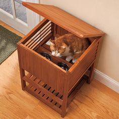 private cat feeding station. this is such a great idea for people who also have dogs. then you don't have to feed them on the counter or in a separate room.
