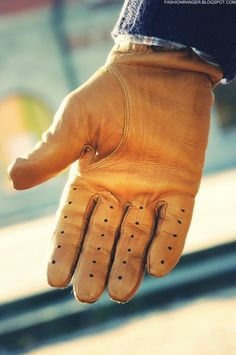Leather driving gloves. You won't regret purchasing a quality pair, I guarantee it.