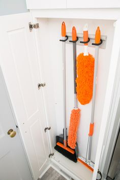 If you don't have room for a full broom closet, a shallow cabinet, like this one from Home Depot, can do the job just as well.