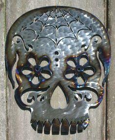 Metal Sugar Skull wall art (found on Etsy).  Man I want a laser cut machine