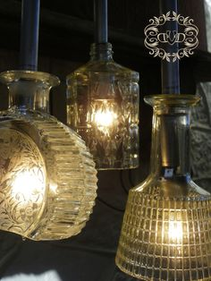 decanter swag light or chandelier....how adorable for a bar, man-cave...or even a patio!