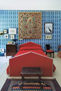 In Ivory's bedroom, custom wallpaper based on an 18th-century English pattern, a Duncan Phyfe chair once borrowed by the Met and, above the headboard, a Suzani from Central Asia.