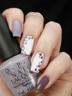 Neutral nails with dotted accents.