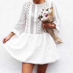 White laser cut dress.