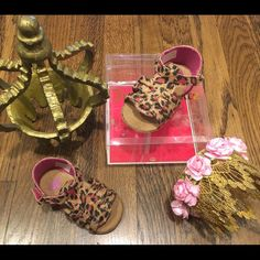 Juicy couture infant cheetah sandals Brand new worn once tiny scuff left tip of sandal not noticeable comes w box 100% authentic. Adorable infant brown, black & pink cheetah print juicy couture sandals w Velcro strap. Size: 3c Selling on Mercari $32 free shipping Juicy Couture Other