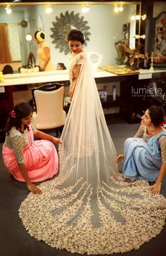 Christian Wedding Gown - White Christian Saree with a Long Net Train | WedMeGood #wedmegood #indianbride #indianwedding #bridal #saree #white #train #trail #southindianbride