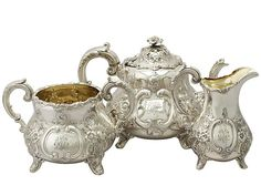'Victorian Tea Set' An exceptional, fine and impressive antique Victorian English sterling silver three piece tea service / tea set.