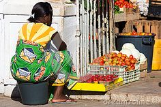 Cape Verdean woman sells vegetables at the market, Praia in the island of Santiago in the archipelago of Cape Verde.