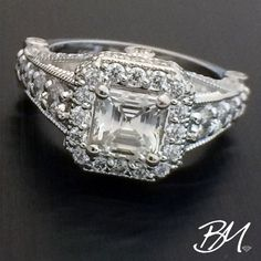 18k white gold #ring w 1.25c center emerald-cut #diamond and .8c of round brilliants in #halo & shoulders! #customjewelry #customring #jewelry #customengagementring #engagementring #wedding #bridal #bridaljewelry