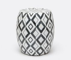 The Ankara stool boasts a bold optical pattern reminiscent of Renaissance flooring. Black and white marble is set in diamonds creating a graphic accent that can be used as a stool or side table.