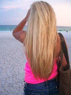 Thick long blond hair. Need to grow ASAP. ha