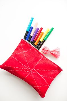 Kid-Made Felt Zipper Pouch. Let kids stitch patterns on top. A fun way to see different stitches and easy beginner sewing project!